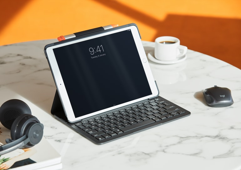 iPad with rugged combo keyboard case and external mouse and headset