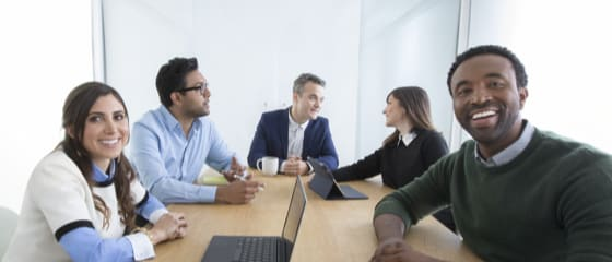 Photo of group talking in a conference room
