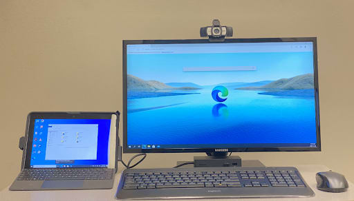 Tablet with keyboard and computer desktop setup with a webcam