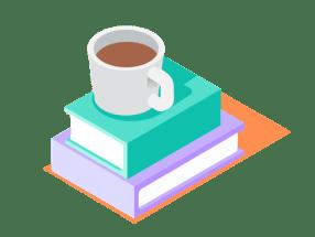 Kuva kahvista kirjojen päällä