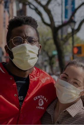Two people wearing protective face masks