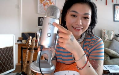 woman using blue yeti mic