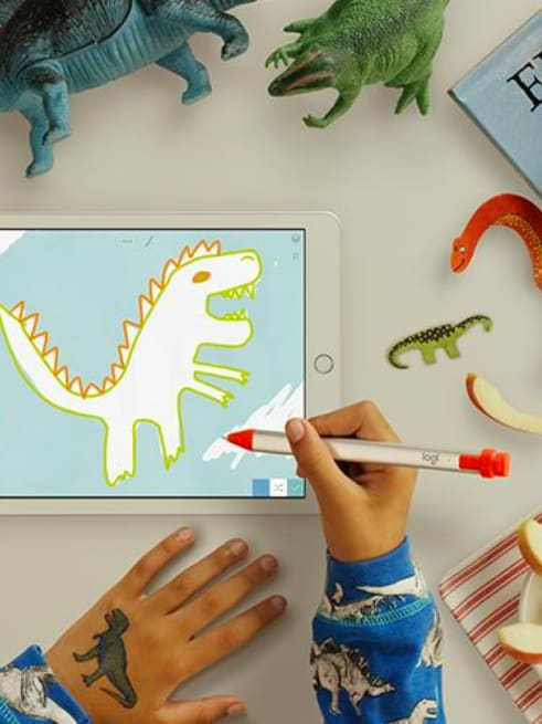 Child drawing on tablet with Logitech Crayon