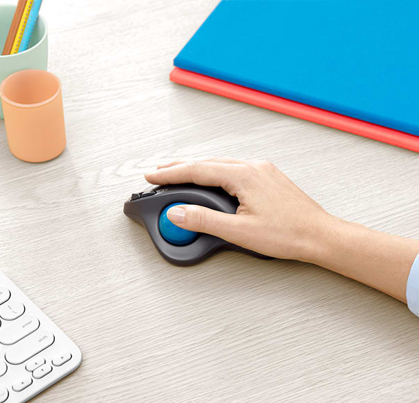 A hand holding a M570 trackball mouse