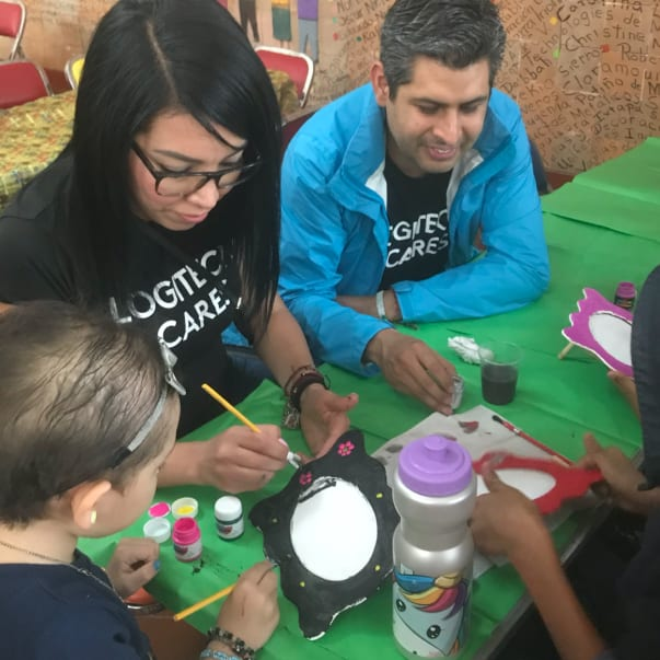 Logicares volunteers painting with kids