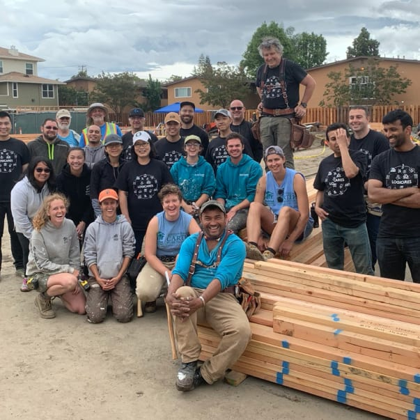 Group photo of volunteers on construction site