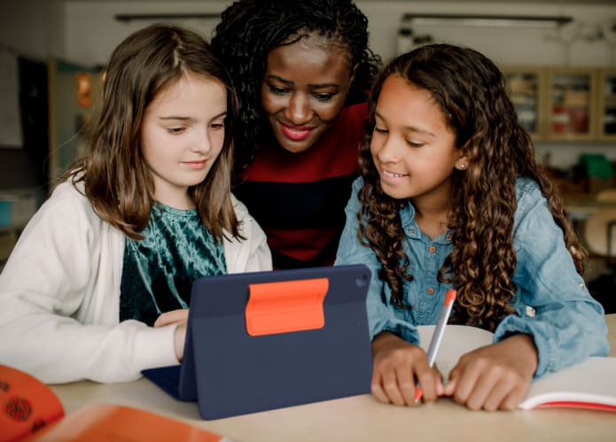 Three Girls using Crayon for Studies