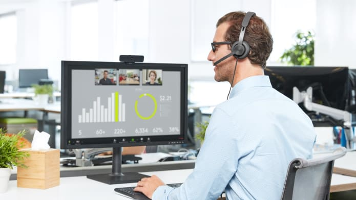 Business setting with Zone Wired headset and the C925e Webcam in use during a video call.