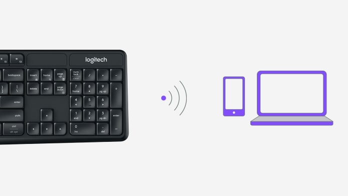 Keyboard showing wireless connection icon to smartphone and laptop