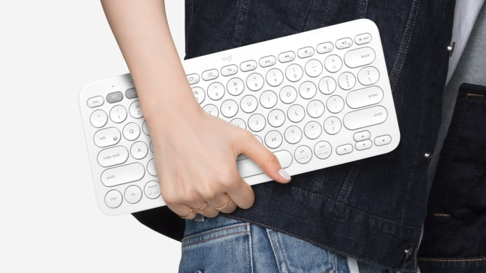 A person carry a portable keyboard one handed