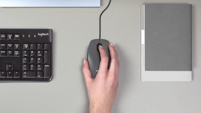 hand gripping computer mouse