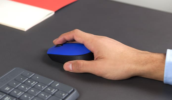 hand gripping blue computer mouse