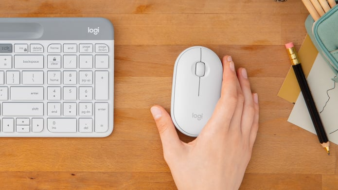 Pebble i345 White Varaint on the Table with Logi Keyboard