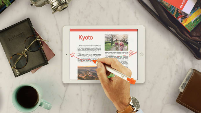 A person using Crayon to annotate on iPad.