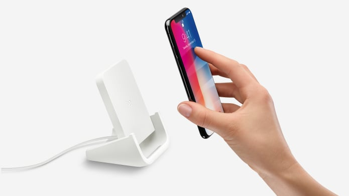 iPhone placed on wireless charging stand