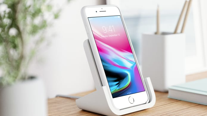 White iPhone on wireless charging stand