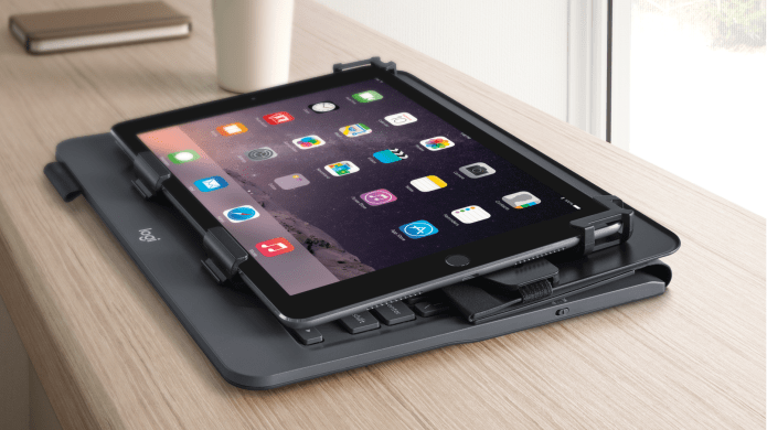 Tablet on table with folio