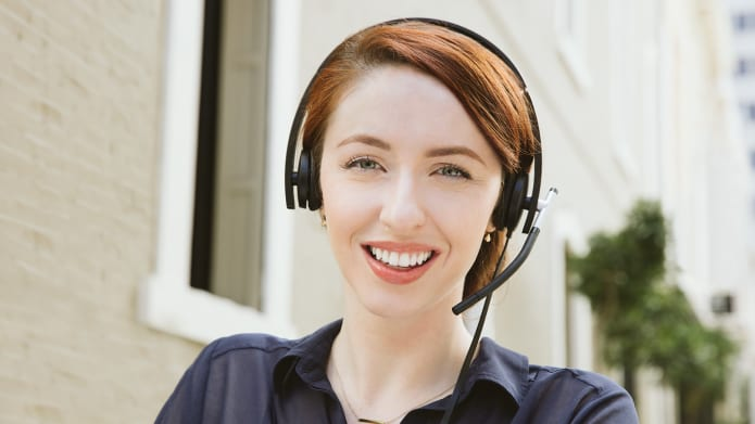 Employee using headset in open space