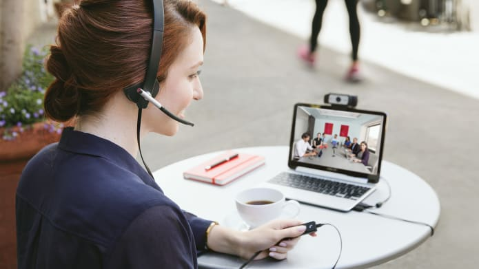 Female employee using headset for video conferencing