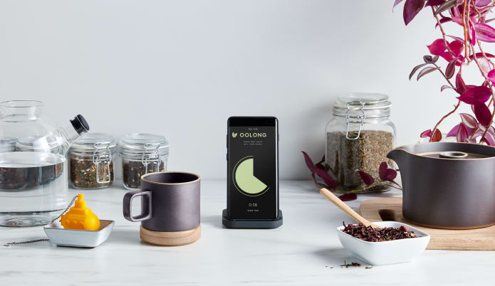 More beauty and less clutter displaying the wireless charger in use with an iPhone
