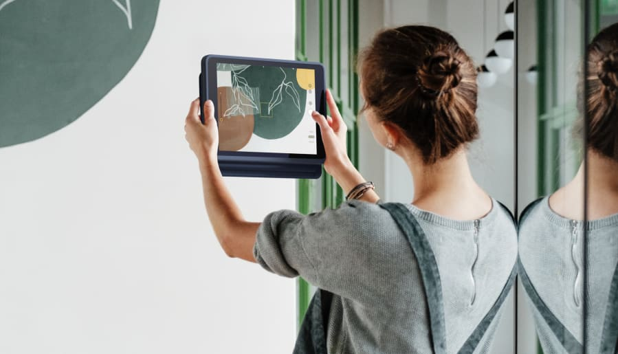 A Girl taking the Picture in iPad using Rugged Combo 3 Touch