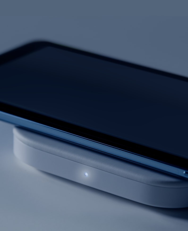 Phone Charging on Logitech Powered Pad with power indicator light glowing